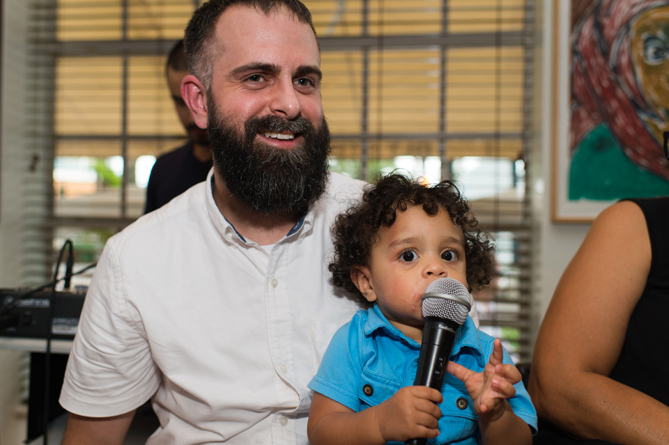 Artist Christopher Metzger (Betsy visiting artist and creator of Black Lives Matter – the exhibit), with his son ZION, at a salon on Rebuilding the City: Image and Deed – at The Betsy during Art Basel Miami Beach, 2015. Photo: Dylan Rives, 2015, used with permission of The Betsy Hotel.