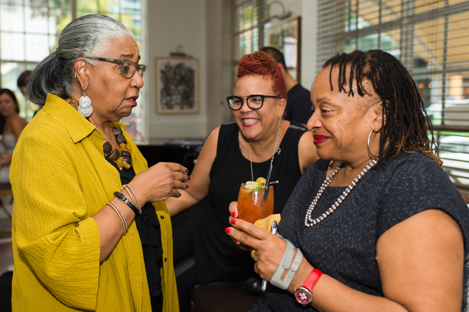 """Betsy Curator, Dr. Leslie King Hammond (Senior Fellow at Robert W. Deutsch Foundation), PRIZM Curator, Rosie Gordon Wallace (Founder of Diaspora Vibe Cultural Arts Incubator), and MacArthur """"Genius"""" Fellowship Winner Deborah Willis (Author and Chair of Photography at NYU – at a Betsy Hotel Salon on her book Question Bridge – during Art Basel Miami Beach week, 2015. Photo: Dylan Rives, 2015, used with permission of The Betsy Hotel."""