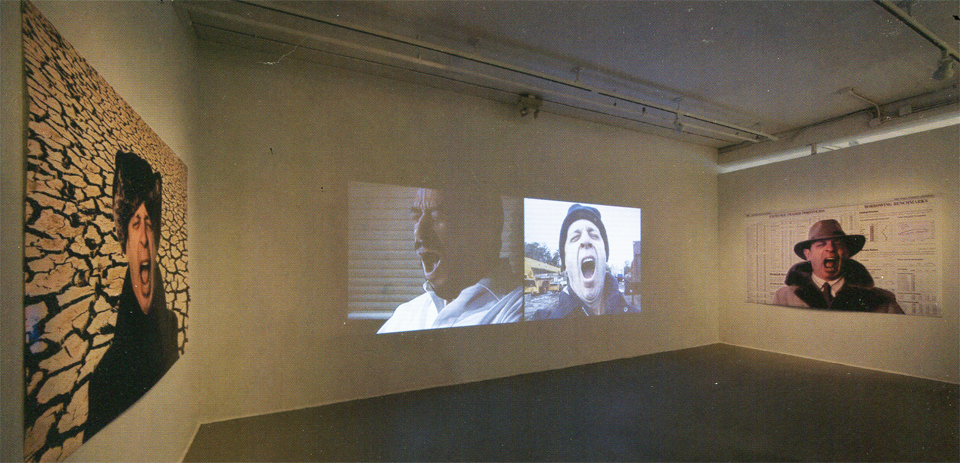 "GLOBAL YAWNING for a small planet, ""a new day is yawning."" Installation view: multi-channel videos, 5 minute loops; digital photos: 89 x 59"", Boston Center for the Arts, 2008. Photo from Mill's Gallery catalog."